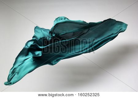 green flying fabric - art object, design element
