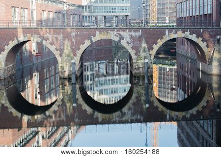 Building reflexion in the water in the Ellerntorsbridge in Hamburg