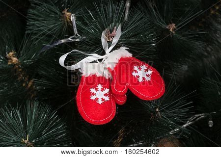 Handmade toy from felt on Christmas tree
