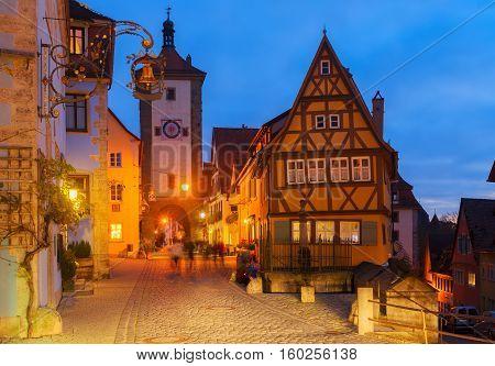 illuminated night street in Rothenburg ob der Tauber, Germany