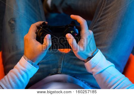 Young gamer playing video game. Very happy.