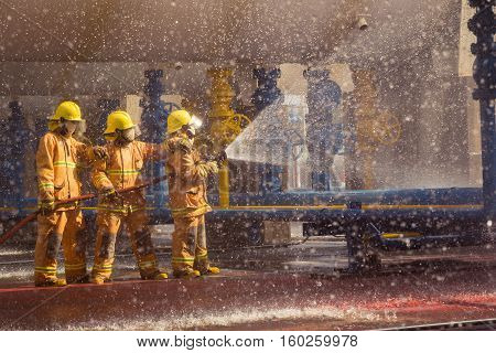 Fireman Showing How To Use A Fire Sprinklers. On A Training Fire.