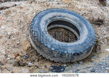 Old tire indicating breeding ground for mosquito