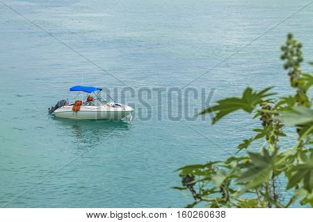 High angle shot of small recreational boat at middle of sea in Tibau do Sul Brazil