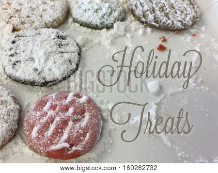 Gingerbread and Shortbread frosted Christmas traditional cookies ready for Santa with the words Holiday Treats written in elegant fancy script good for promotion campaigns social network image or blog posts on holiday desserts