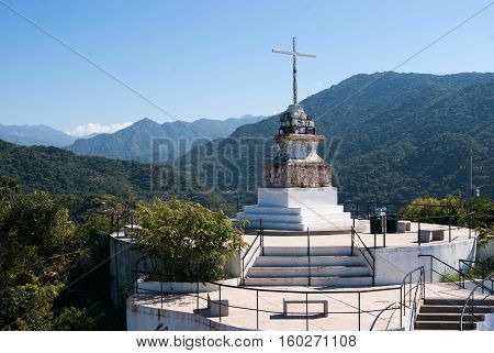 The cross on top of the hill called El Mirador in Puerto Vallata
