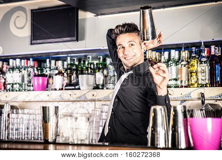 Flair bartender in action. Making freestyle moves at the bar