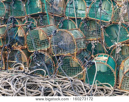 LUARCA SPAIN - DECEMBER 4 2016: Lobster traps at the fish market pier in Luarca Spain.
