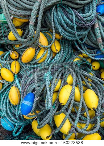 LUARCA SPAIN - DECEMBER 4 2016: Blue and yellow fishing gear at the fish market pier in Luarca Spain.