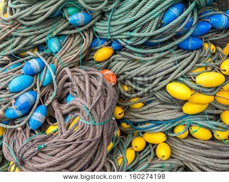 LUARCA SPAIN - DECEMBER 4 2016: Colorful fishing gear at the fish market pier in Luarca Spain.