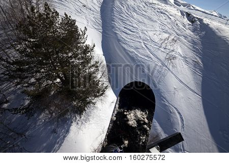 Snowboard Over Off-piste Slope In Sun Winter Day