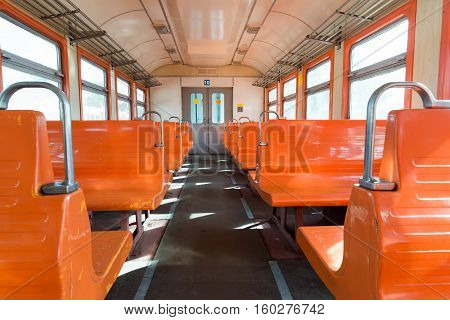 Orange suburban electric train in a Moscow, Russia