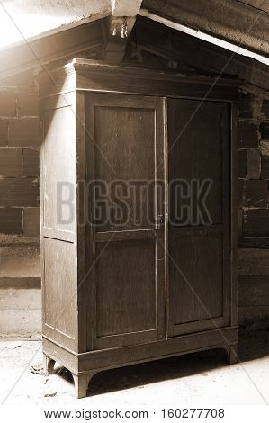 old wooden cabinet in a dusty attic of the house