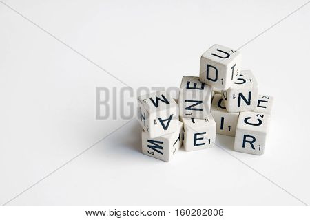 Pile Of Cubes With Letters And Numbers On White