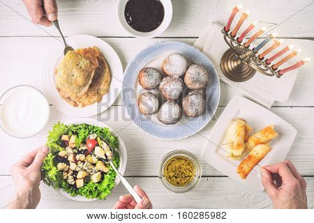 Hanukkah dinner with traditional dishes horizontal, ritual, background