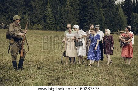 PERM RUSSIA - JULY 30 2016: Historical reenactment of World War II summer 1942. Soviet soldier and civilians.