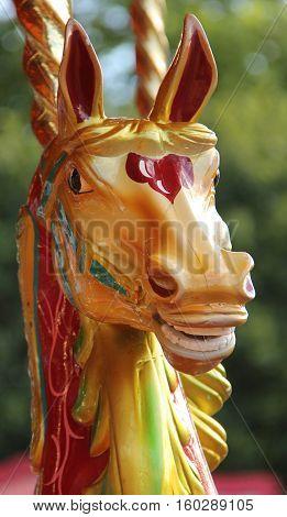 Head of a Wooden Carousel Horse on a Fun Fair Ride.