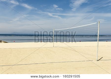 Volleyball net on empty sand beach sunny day. Bali, Indonesia