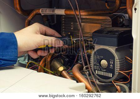 Master repairing gas equipment wall-mounted gas boiler