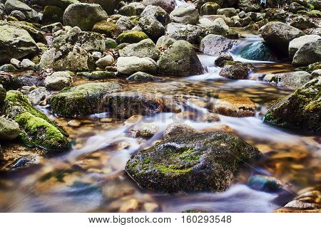 Mountain stream in the spring in the Giant Mountains Poland