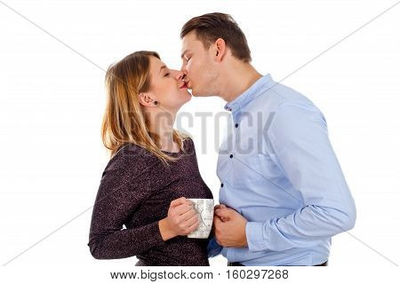 Picture of a happy young couple posing on an isolated background