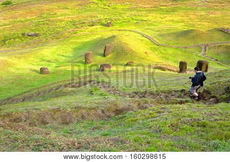 Photographer walking down stairs on Easter Island Chile