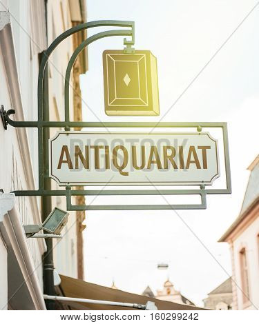 TRIER, GERMANY - FEB 2014: Vintage antiquariat or used bookstore sign on old building facade