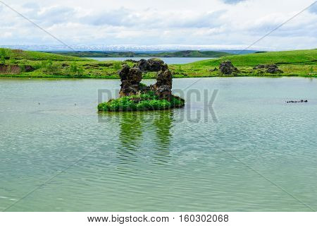 Lake Myvatn With Various Volcanic Rock Formations