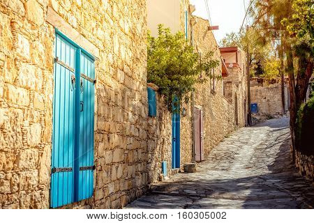 Narrow uphill cobbled street at Lofou village. Limassol District Cyprus.