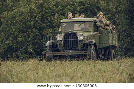 PERM RUSSIA - JULY 30 2016: Historical reenactment of World War II summer 1942. Soviet soldiers in a truck