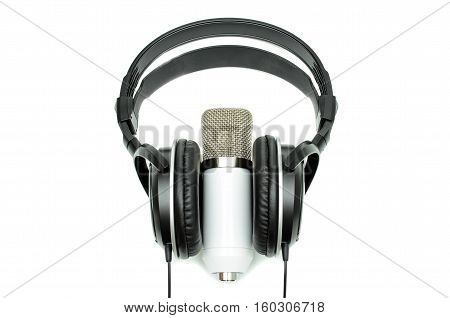 White microphone and black headphones isolated on white background