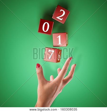 Dice rolled by a hand. Bet on the happy new year concept