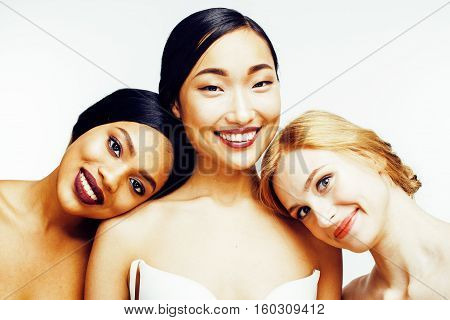 three different nation woman: asian, african-american, caucasian together isolated on white background happy smiling, diverse type on skin, lifestyle people concept close up