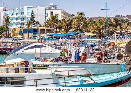AYIA NAPA - JULY 16 2016: Numerous fishing boats and yachts in port of Ayia Napa.