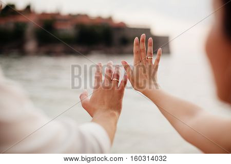 Wedding Rings On Hands Close Up