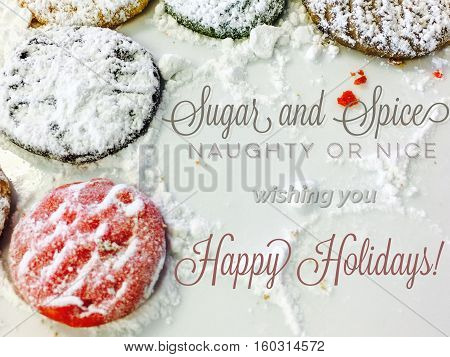 Fun Christmas Card or general seasons greetings card for social media community or business with words: Naughty or nice and sugar and spice playful words on winter background with shortbread cookies sugar and crumbs with room to add hashtag or logo