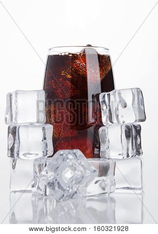 Glass of cold cola soda drink with ice cubes on white background