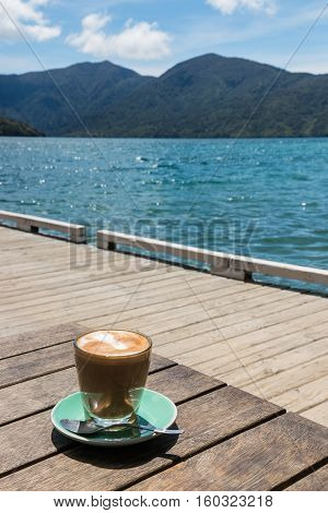 caffe latte with jetty and ocean in background