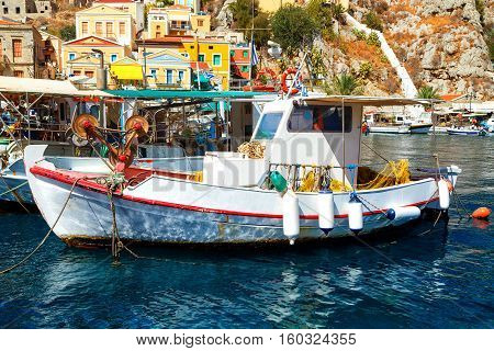 Symi island - Colorful houses and small boats at heart of the village