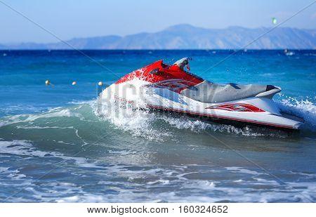 Jet Ski Moored inon on waves sea