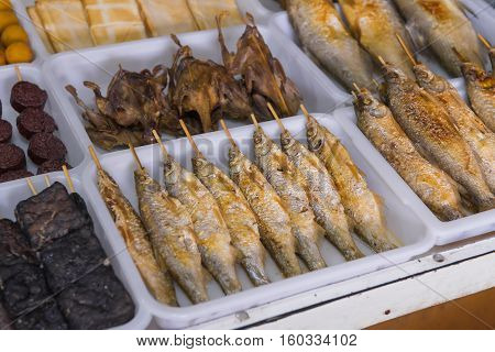 Salted Grilled Fish On The Grill In Market