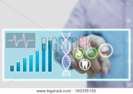 Doctor using futuristic touch screen technology for scientific research.