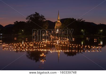 light in Buddha Statue at Temple in Loy Kratong Festival Sukhothai Historical park Thailand