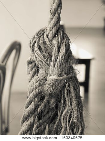 Old big brown tied natural rope knot with vintage effect