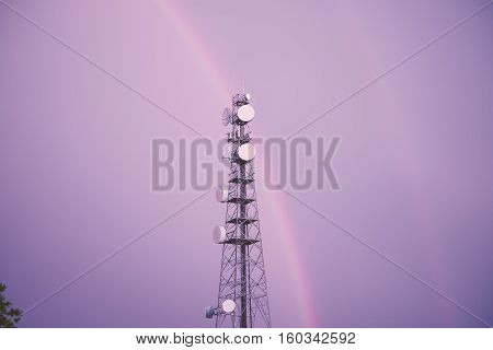 Radio Tower In Queensland With A Rainbow.