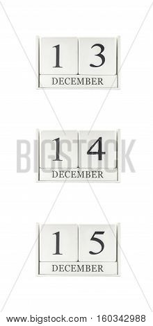Closeup group of white wooden calendar with black 13 14 15 december word three date calendar isolated on white background