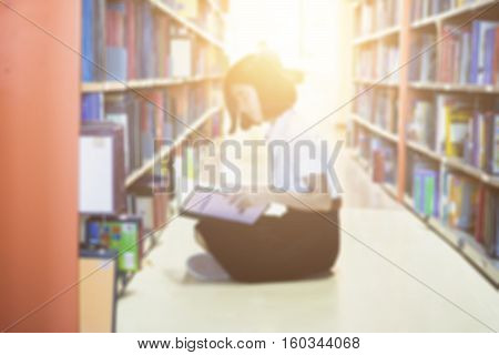 Blurred of Asian student in uniform reading in the library at university and Research Knowlege