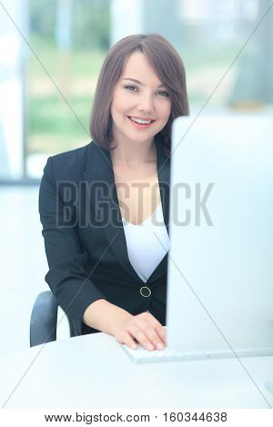 Businesswoman at the office working on a computer