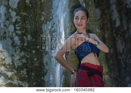 Laos Woman And A Big Tree