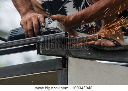 Worker working hard of a grinding machine